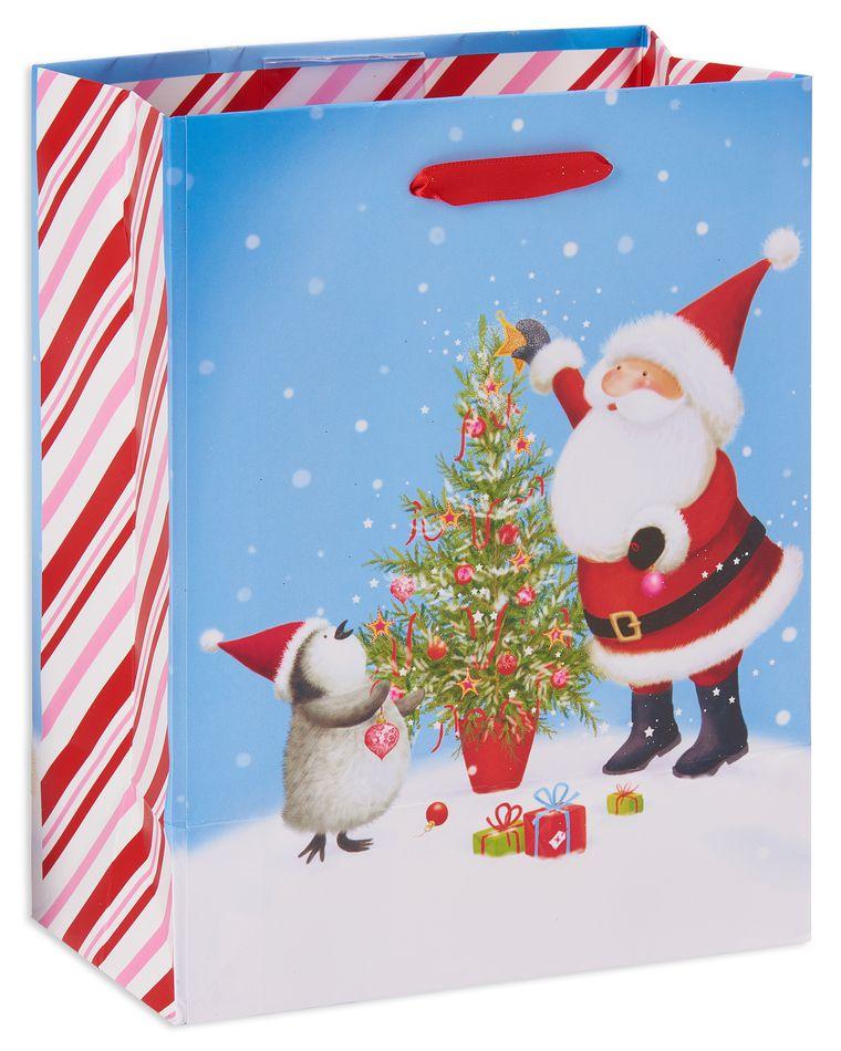 small santa and penguin christmas gift bag