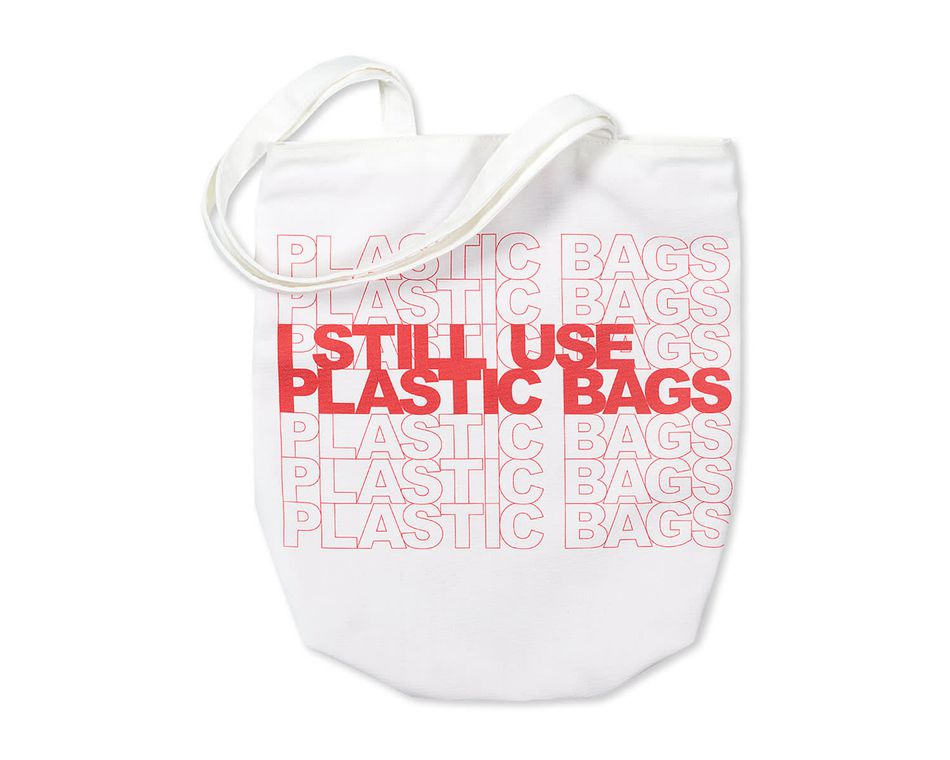 i still use plastic bags tote bag