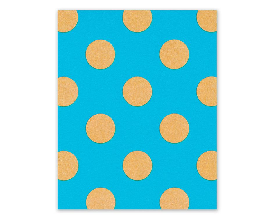kraft dots on blue wrapping paper sheet