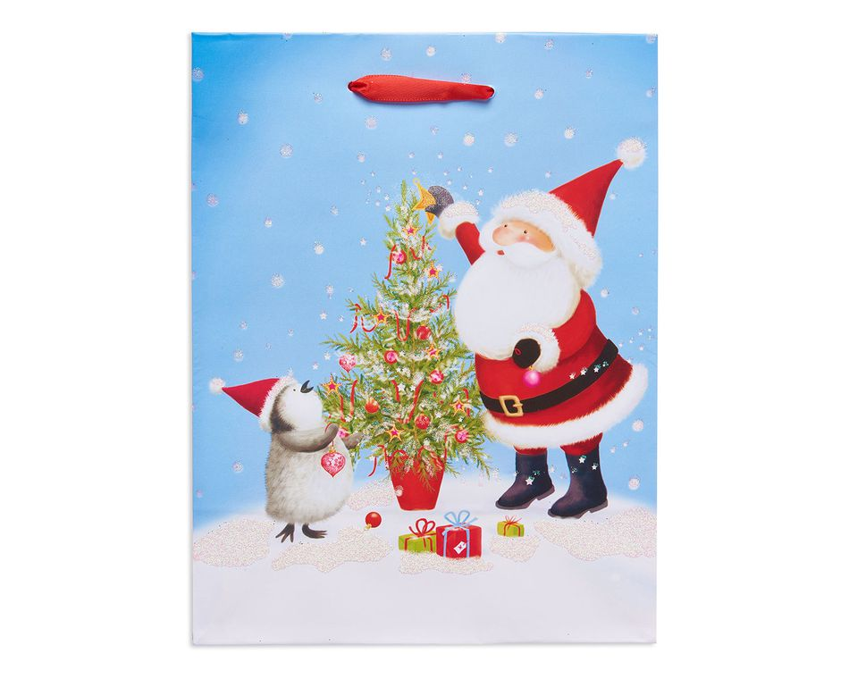 small santa and penguin christmas gift bag